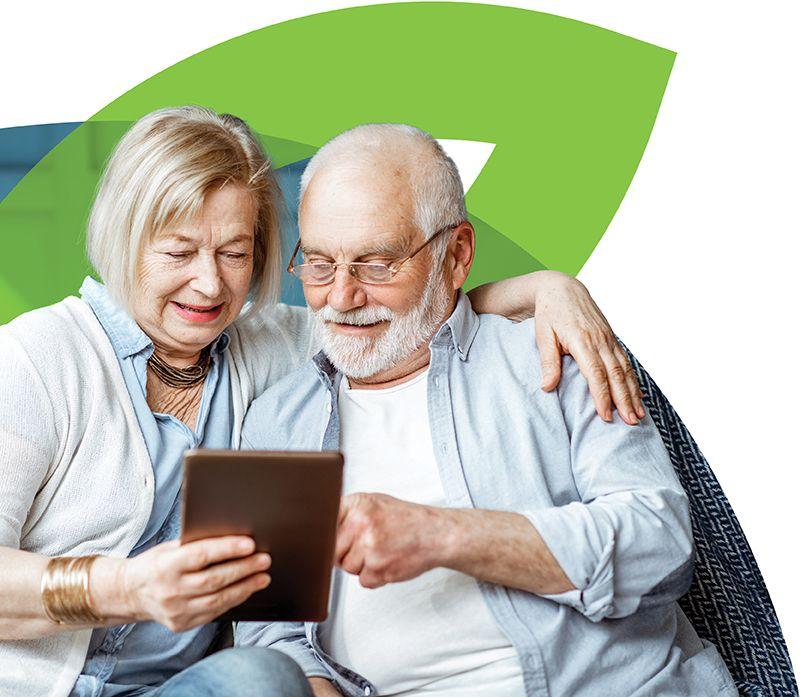 Senior couple using an iPad to access the CenterWell health portal