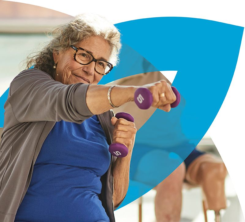 Senior woman exercising with dumbbells