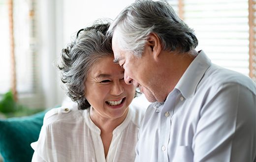 Senior Asian couple smiling and laughing